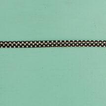 Passepoil à pois noir 10 mm gros plan